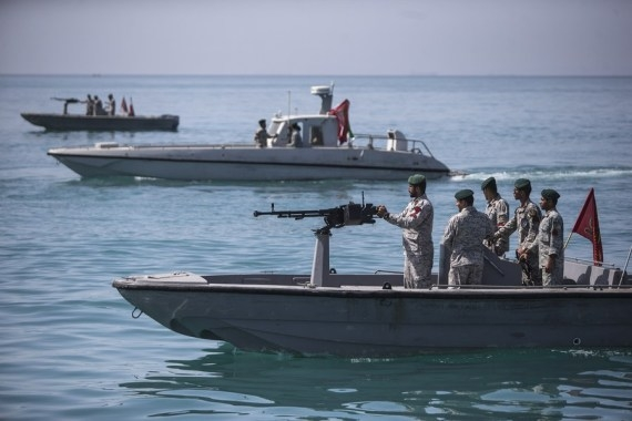 US ship fires warning shots in encounter with Iranian vessels