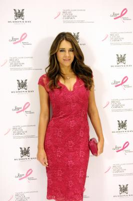 Liz Hurley slammed for wearing cleavage-baring dress with son