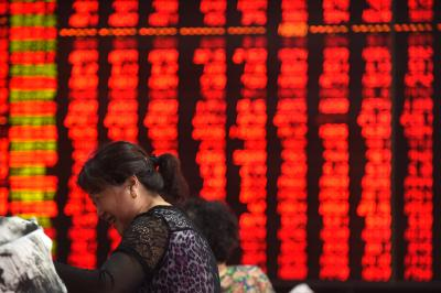 Chinese shares open lower; yuan weakens
