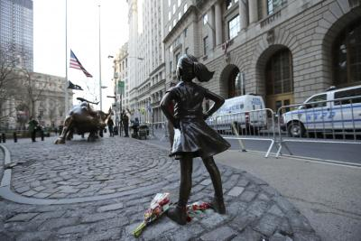 Fearless Girl defying Wall Steet s Charging Bull to move