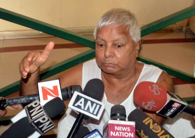 Modi misusing power to campaign for BJP: Lalu