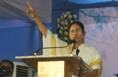 Mamata breathes fire on BJP, dares it to jail any TMC worker (Second Lead)
