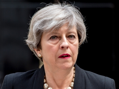 May defends legality of Syria attacks in parliament