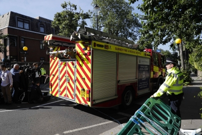 London inferno toll reaches 30, over 70 unaccounted for (Lead)