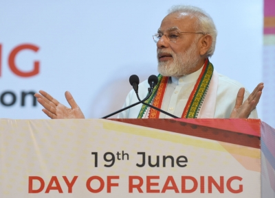 Gift a book, not bouquet, as greeting: Modi