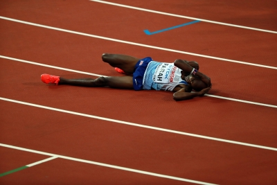 Bolt pulls up injured in final race of his career