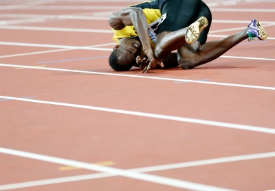 Injured Bolt crashes out in men s relay (Lead)