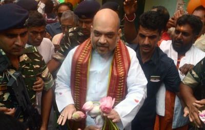 Amit Shah has lunch at BJP worker s house, interacts with family