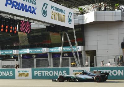 Hamilton claims pole position in Malaysia as Vettel to start from last