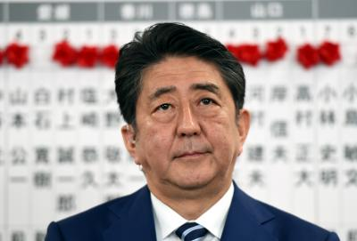Japan s ruling camp wins two-thirds majority in lower house election