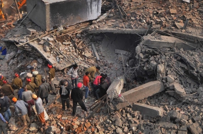 Dozens feared trapped after building collapses in India