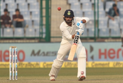 Vijay brings up ton as play resumes after rain in one-off Test