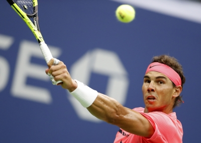 Nadal downplays Federer s absence at French Open