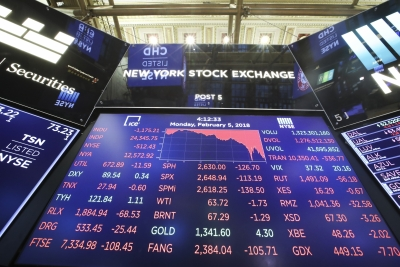 Wall Street tumbles after US tops world in COVID-19 cases