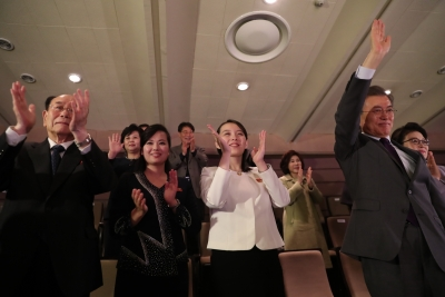 Kim Jong-un meets orchestra that performed at Winter Olympics