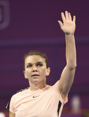 Halep beats Wang to reach BNP Paribas quarters