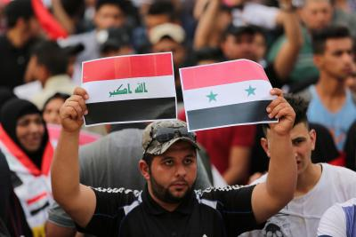 Thousands rally in Baghdad to protest attack on Syria