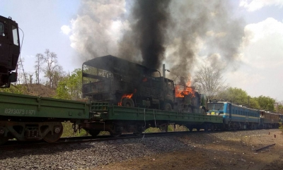 Four army trucks burnt in fire on goods train