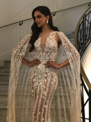 Deepika looks  angelic  in white caped gown at Cannes