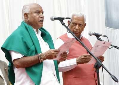 Yeddyurappa takes oath as CM, Congress, JD-S protest (Roundup)