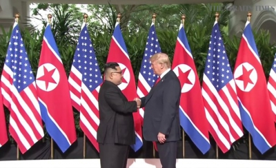 Trump, Kim begin summit meeting in Singapore (Lead)