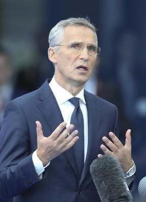 NATO leaders vow to improve burden sharing balance