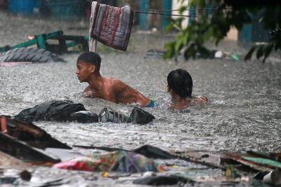 Filipinos grapple as heavy rains lash country