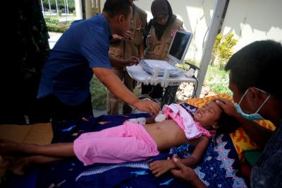 Death toll in Indonesia earthquake reaches 387