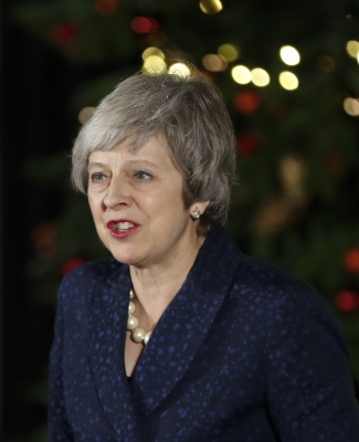 May to join EU summit after surviving no-confidence vote