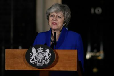 May pushes for cross-party consensus after surviving no-confidence vote