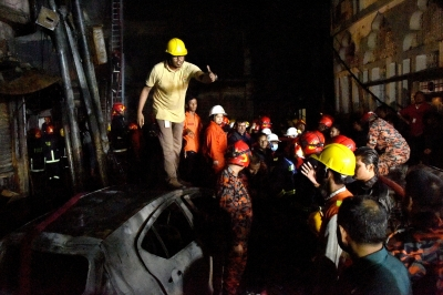 70 killed, 40 hurt in Dhaka apartment fire (Night Lead)