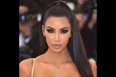 Kim shares pictures of times she 'taped up' her breasts