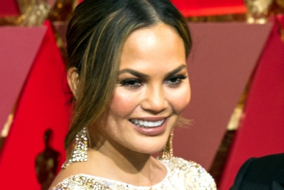 Chrissy Teigen wishes her implants 'Happy 10th Anniversary', but wants them out now