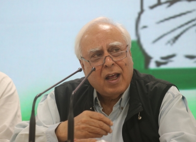 You gave in to Trump's threats: Sibal to PM