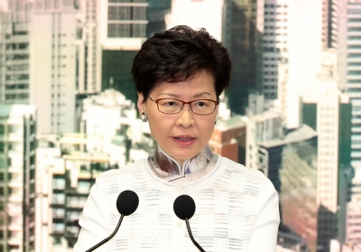 China backs HK chief, slams 'local, external forces'