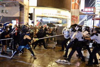Hong Kong police fire gun, use water cannon on protesters