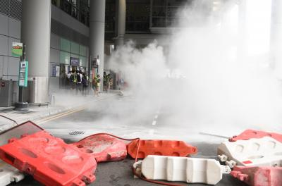 180 arrested, tear gas fired in fresh HK protests