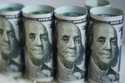 US dollar edges down amid coronavirus uncertainty