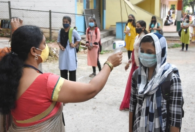 Bengaluru: A candidate undergoes COVID-19 screening as she arrives to appear for Karnataka Board Class 12 (2nd PUC) Examinations postponed due to the ongoing nationwide lockdown imposed to mitigate the spread of coronavirus, in Bengaluru on June 18, 2020. (Photo: IANS)