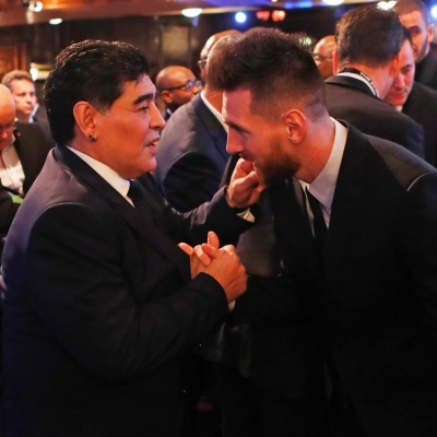 Maradona & Messi: Two symbolic extremes of a football superstar (Lead)
