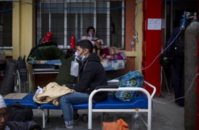 Kathmandu: Patients infected with COVID-19 are seen outside the corridor of a hospital in Kathmandu, Nepal, on May 11, 2021. (Photo by Sulav Shrestha/Xinhua/IANS)